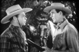 Film screen image of Rod Cameron (right) and Eddie Dew