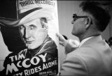 Rev. Mack Houston examining a Tim McCoy poster