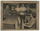 Barbara Eidson at piano with choir members