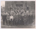 Men and boys assembled in front of church