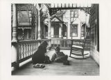 Mildred Marsh and Rodney Marsh playing on the porch