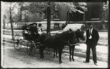Children riding on pony cart