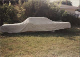 Dodge vehicle under tarp