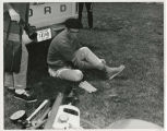 Unidentified man putting on boots in Indianapolis Motor Speedway infield