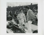 Mario Andretti talking to crew member in pit road