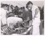 A. J. Foyt and crew working on car