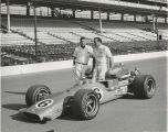 A. J. Foyt and crew member beside car