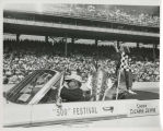Suzanne Devine, 500 Festival Queen, riding in pace car with Borg-Warner trophy
