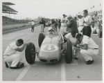 Len Sutton in car as pit crew makes adjustments