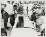 Paul Russo in car surrounded by Andy Granatelli and pit crew