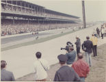 Fans and film crew look in during Indianapolis 500