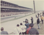 Fans and film crew look on during Indianapolis 500