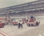 Emergency and maintenance vehicles facing Indianapolis Motor Speedway paddock