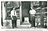 J. E. Sears, Sr. in front of tailor shop