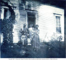 Brown family at farmhouse in Mt. Pleasant Twp., Indiana