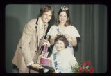 Dick Hester and Heidi Reiter present tiara and trophy to Miss Ball State Sue Ellen Cain, 1976