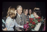 Pres. John J. Pruis presents roses to Miss Ball State Sue Ellen Cain, 1976