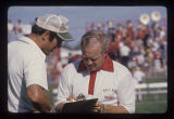 Coach Dave McClain coaching a Ball State University Cardinals football game, 1975