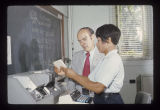 James R. Barnhardt and student using a computer for accounting class, 1974