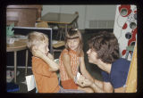 Ball State University student working with children for a special education class, 1974