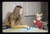Ball State University student working with a child for a special education class, 1974