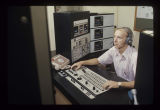 Program director Ron Wolfe working the control board at WIPB-TV