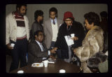 Civil rights leader Ralph Abernathy signing autographs