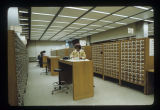 Students searching card catalog at Bracken Library