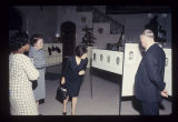 Erskine Caldwell and wife Virginia admire her sketches with Marie Fraser at the Art Gallery