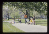 Ball State University students sitting on lawn in Old Quadrangle