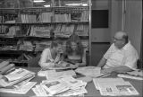 Ball State University journalism professor Louis Ingelhart with students reading newspapers, 1977