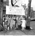 Pres. John R. Emens and students putting up Ball State University sign