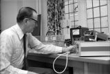 Professor of Physiology and Health Science James E. Griffin in the lab
