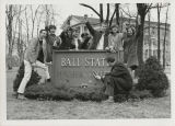 Ball State Unversity students removing Teachers College from sign
