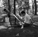 Ball State Teachers College student painting outdoors