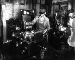 Warner Gear Company worker at machine