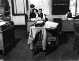 Muncie Evening Press Newsroom, Dick Greene, Center; Herb Silverberg, Right