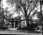 Frank C. Ball house, view of house, grounds and Frank Hauley Lincoln automobile parked in drive