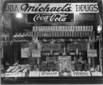 Michael's Drugs (121 S. Walnut, Muncie), window display of Vitalis and Mensil Tonics